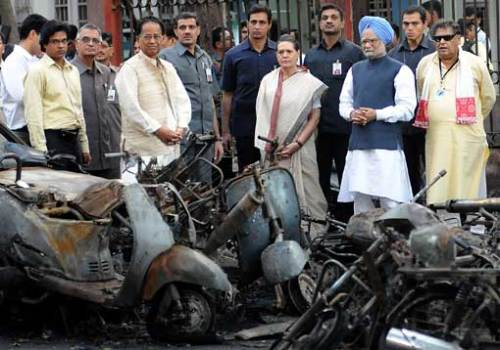 Indian Prime Minister Manmohan Singh and UPA chairperson Sonia Gandhi at bomb blast site at Guwahati, Assam last month